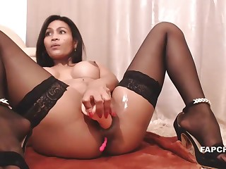 Delicious Tenebrous Latina Works Her Snatch