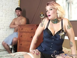 Tattooed blonde slutty blonde MILF Candy Monroe fucks a big black cock